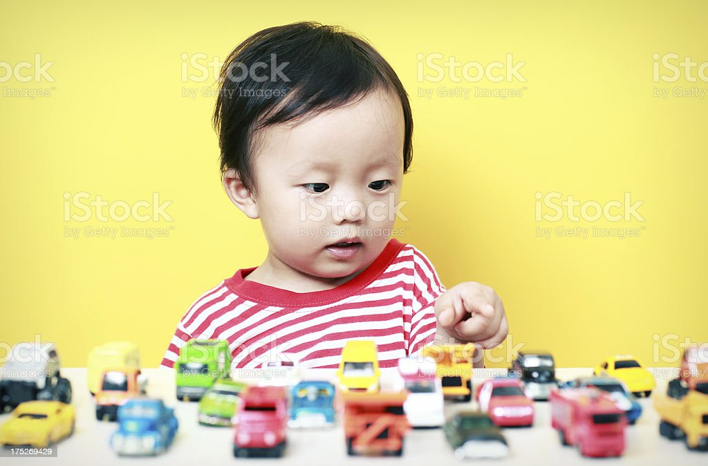 Cute Asian baby playing with car royalty-free stock photo