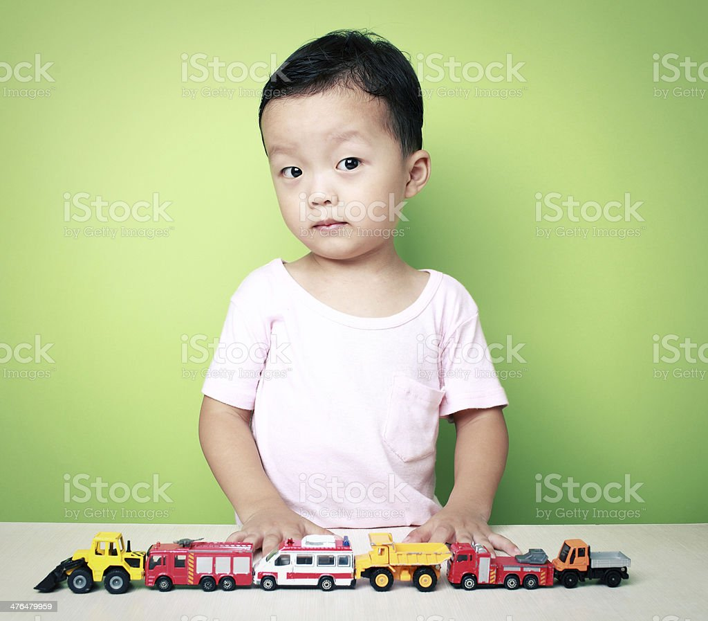 Cute Asian boy and toy car royalty-free stock photo