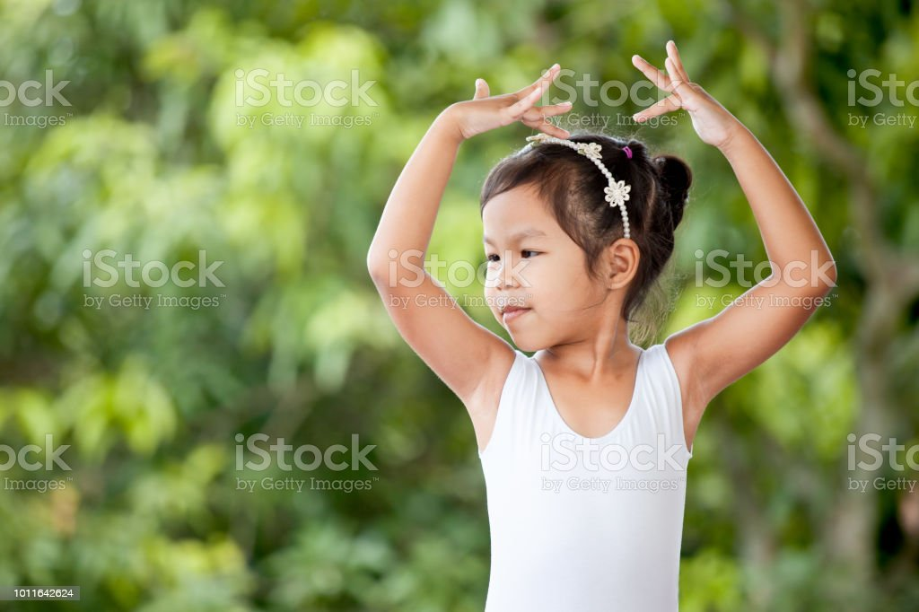 Cute asian child girl is practicing a ballet and dream of become ballerina Cute asian child girl is practicing a ballet and dream of become ballerina Art Stock Photo