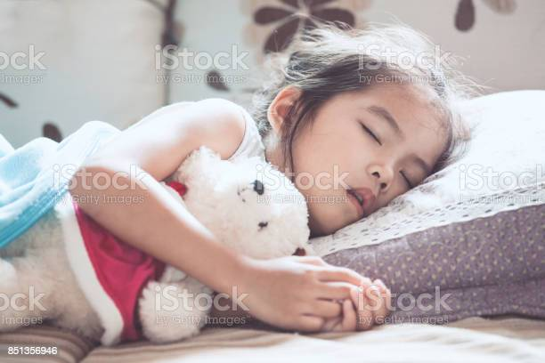 Cute asian child girl sleeping and hugging her teddy bear in the bed picture id851356946?b=1&k=6&m=851356946&s=612x612&h=4nak kooii6ihbiqpbifyfwxjwx8vgqv26hshhj5xes=