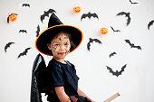 istock Cute asian child girl wearing halloween costumes and makeup having fun on Halloween celebration 1170811213