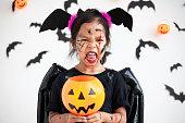 istock Cute asian child girl wearing halloween costumes and makeup having fun on Halloween celebration 1170811214