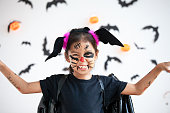 istock Cute asian child girl wearing halloween costumes and makeup having fun on Halloween celebration 1170811217