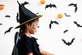 istock Cute asian child girl wearing halloween costumes and makeup having fun on Halloween celebration 1170811221