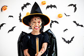 istock Cute asian child girl wearing halloween costumes and makeup having fun on Halloween celebration 1170811226