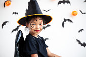 istock Cute asian child girl wearing halloween costumes and makeup having fun on Halloween celebration 1170811237