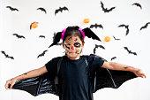 istock Cute asian child girl wearing halloween costumes and makeup having fun on Halloween celebration 1170811239