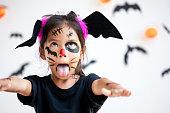 istock Cute asian child girl wearing halloween costumes and makeup having fun on Halloween celebration 1170811240