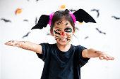 istock Cute asian child girl wearing halloween costumes and makeup having fun on Halloween celebration 1170811247
