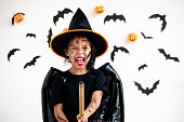 istock Cute asian child girl wearing halloween costumes and makeup having fun on Halloween celebration 1170811250