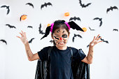 istock Cute asian child girl wearing halloween costumes and makeup having fun on Halloween celebration 1170811261