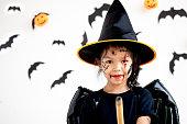 istock Cute asian child girl wearing halloween costumes and makeup having fun on Halloween celebration 1170811265