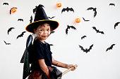 istock Cute asian child girl wearing halloween costumes and makeup having fun on Halloween celebration 1170811269