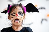 istock Cute asian child girl wearing halloween costumes and makeup having fun on Halloween celebration 1170811274