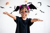 istock Cute asian child girl wearing halloween costumes and makeup having fun on Halloween celebration 1170811953