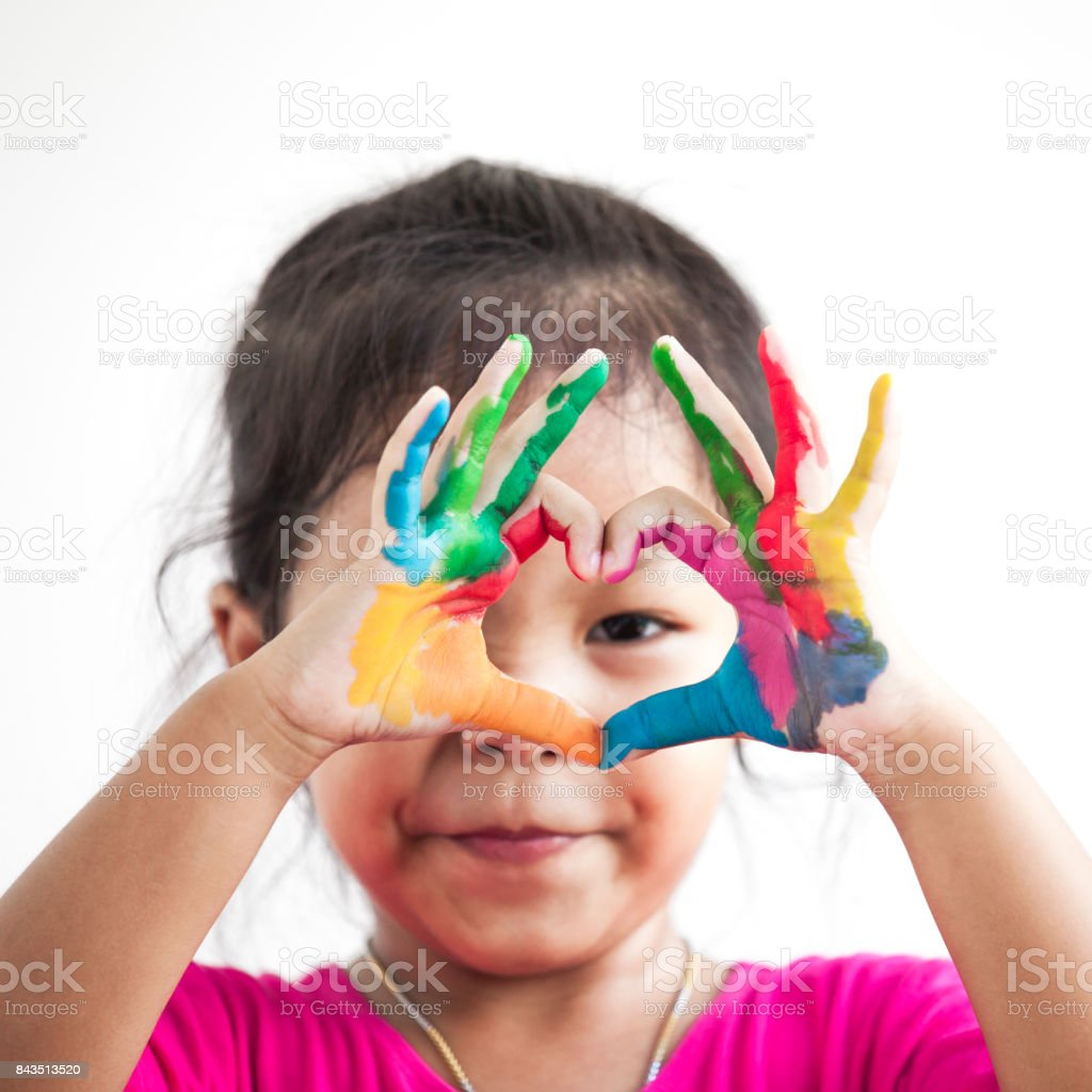 Cute asian child girl with hands painted make heart shape on white background stock photo