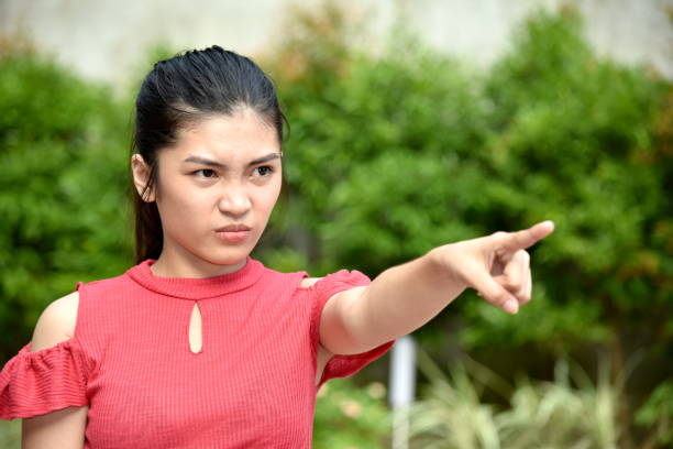 A Cute Asian Female And Anger A person in an outdoor setting antagonize stock pictures, royalty-free photos & images