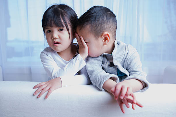 cute asian girl and boy being playful - little girls little boys kissing love stock photos and pictures