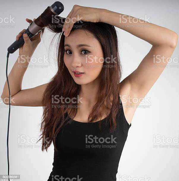 Cute Asian Girl Curling Hair Stock Photo - Download Image Now