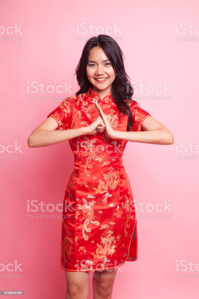 Cute Asian Girl In Chinese Red Cheongsam Dress Royalty Free Stock Photo