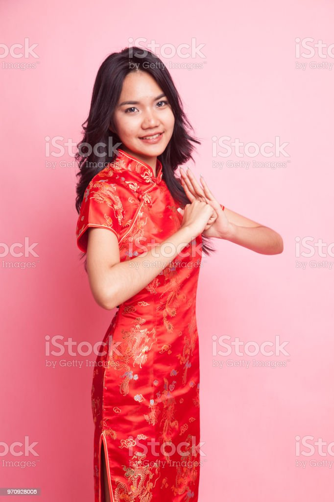 4517f7810 Cute Asian girl in chinese red cheongsam dress royalty-free stock photo