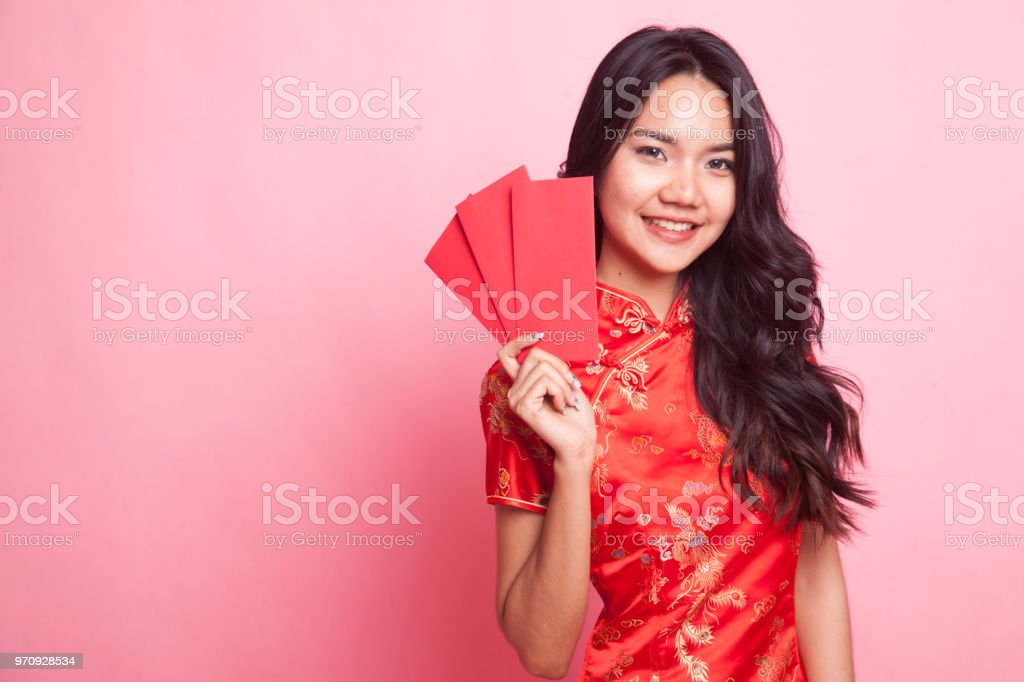 397d172df Cute Asian girl in chinese red cheongsam dress with red envelope - Stock  image .