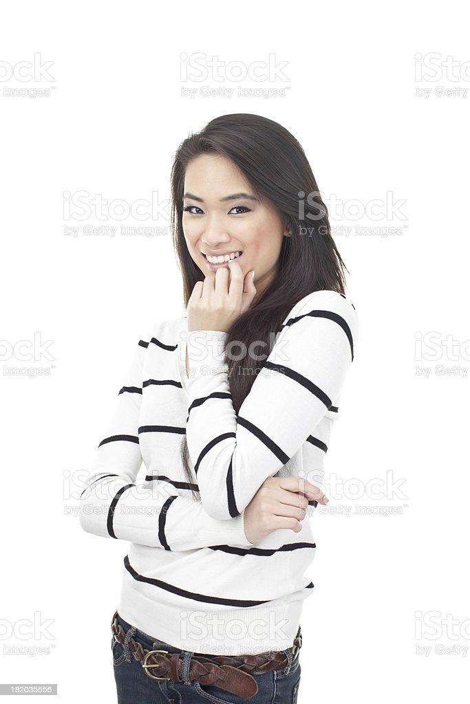 cute asian girl smiling and biting nail royalty-free stock photo