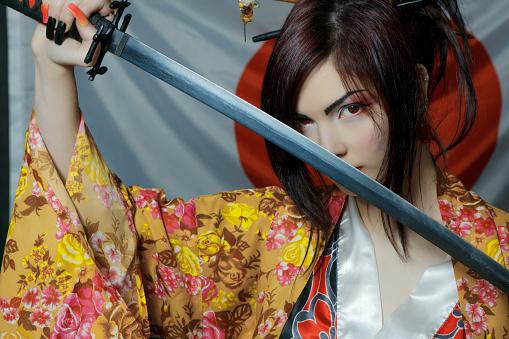 istock Cute asian girl with katana 996931286