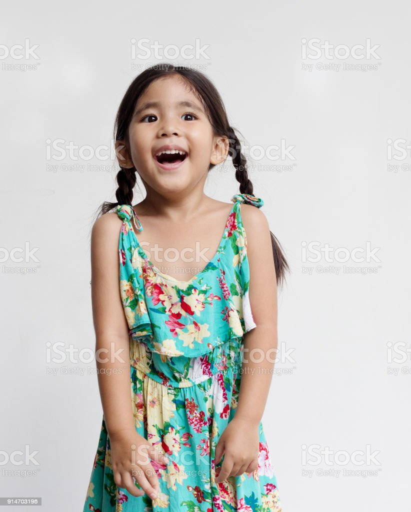 ab3866a62 cute asian kids girl screaming or laugh action on white background  royalty-free stock photo