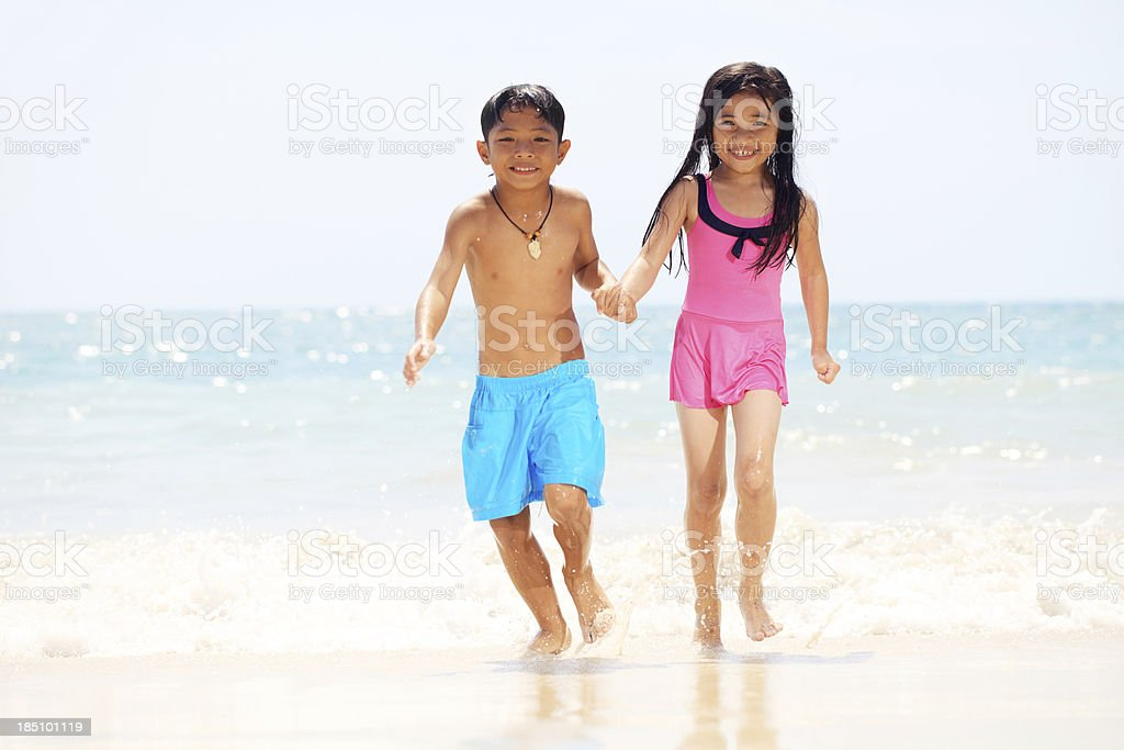 Cute Asian Kids Running On The Beach Royalty Free Stock Photo