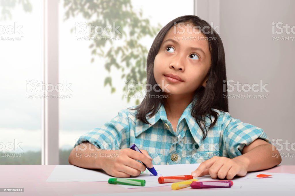 Cute Asian Little Child Drawing With Colorful Crayon Stock