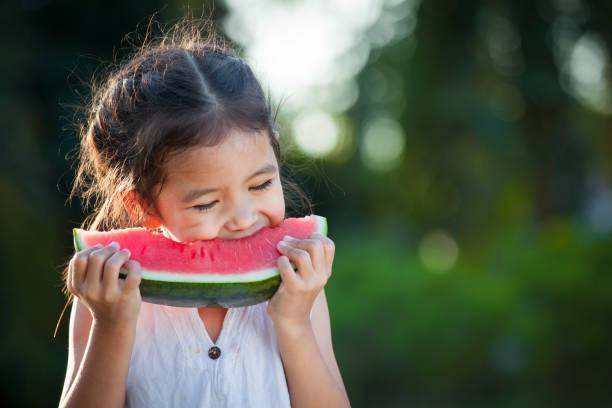 Cute asian little child girl eating watermelon fresh fruit in the picture id907930534?b=1&k=6&m=907930534&s=612x612&w=0&h=pkv0txnet1z2g 3lmqz t5087fnu f7aeptqrzfnrus=