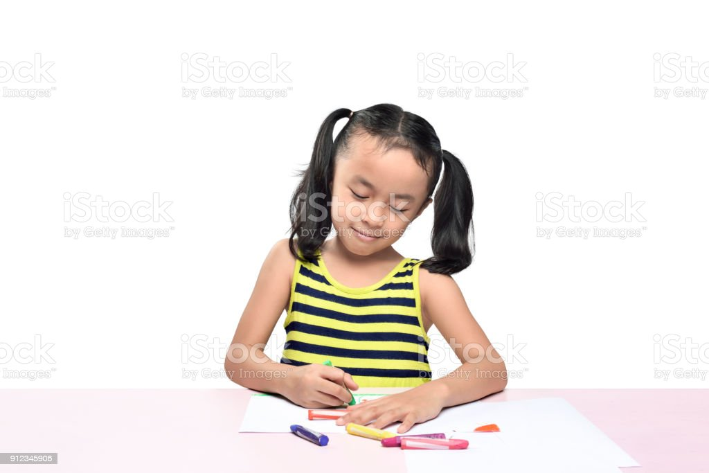 Cute Asian Little Girl Drawing On The Table Stock Photo