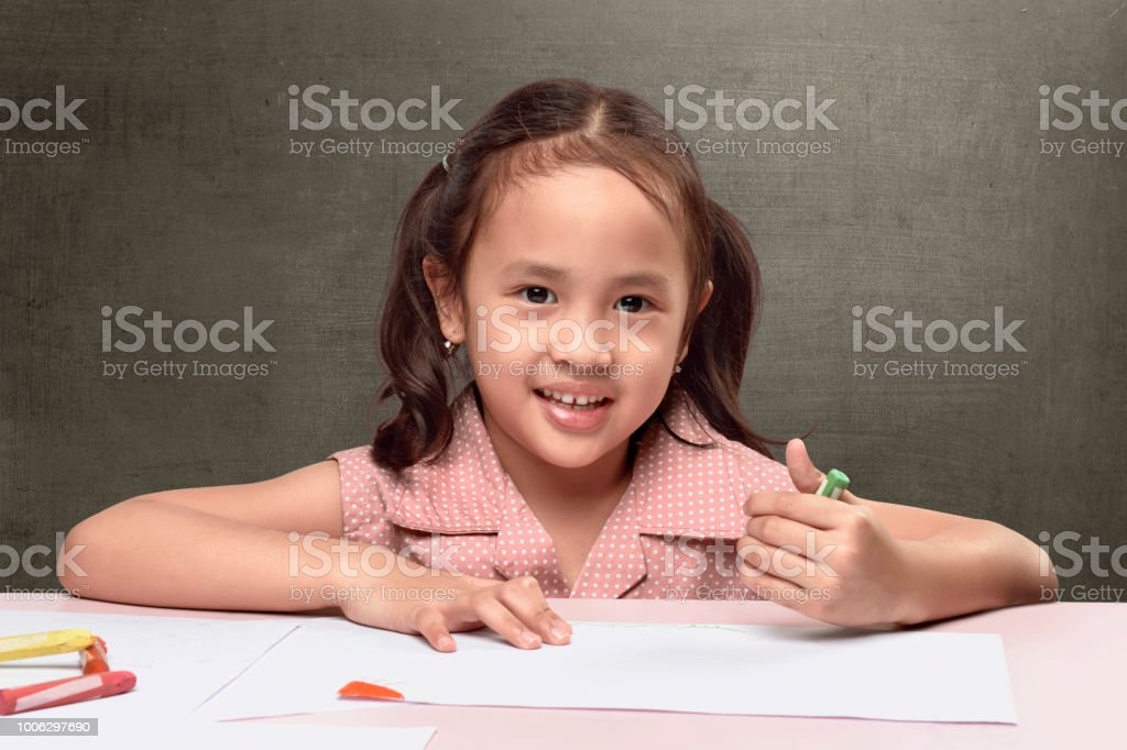 Cute Asian Little Girl Drawing On White Paper Stock Photo