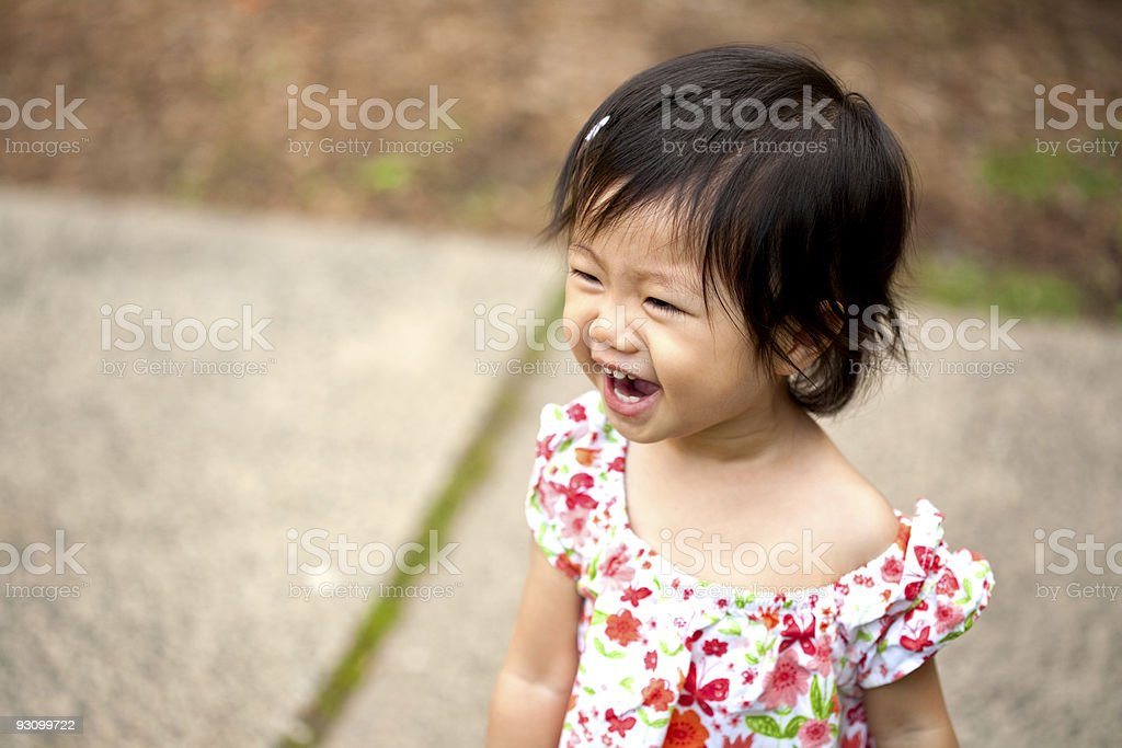 Cute Asian Toddler Laughing royalty-free stock photo