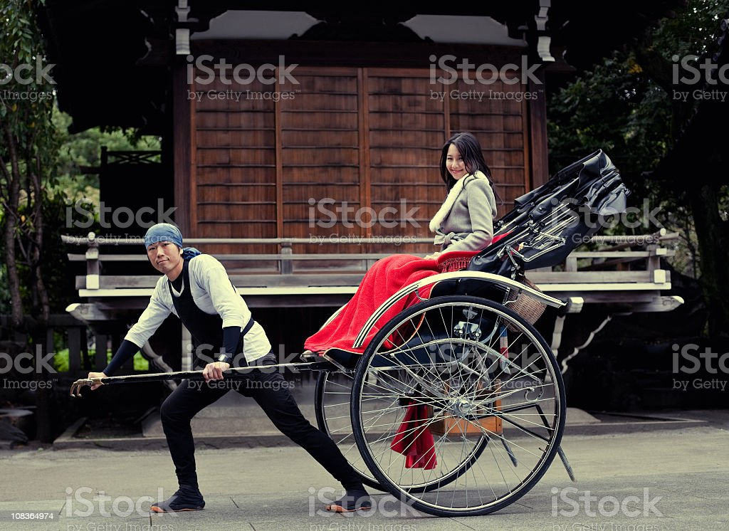 Cute asian woman pulled by a rickshaw royalty-free stock photo