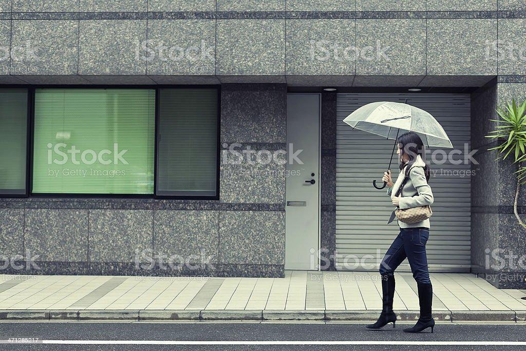 Cute asian woman walking at the streets royalty-free stock photo