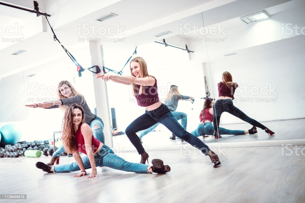 Cute Athletes Posing In Gym In Casual Clothing stock photo