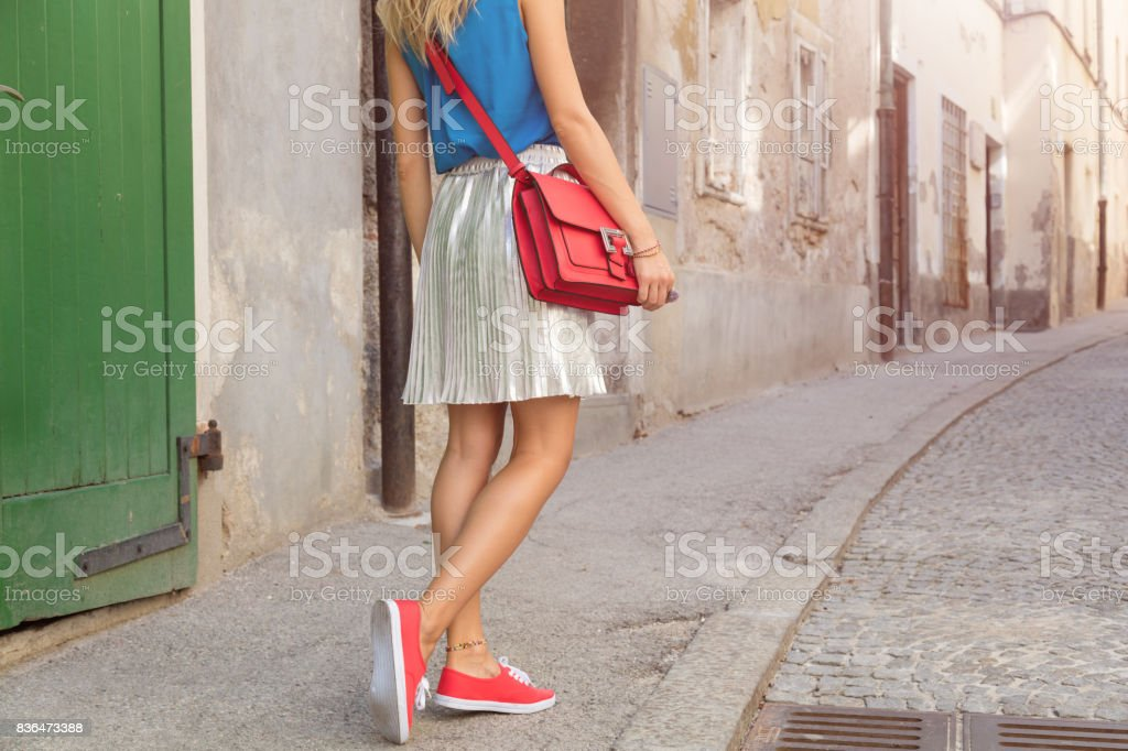 Cute attractive fashionable girl posing in the old European street. Fashion details. stock photo