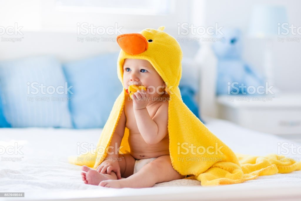 63d5ad113 Cute Baby After Bath In Yellow Duck Towel Stock Photo   More ...
