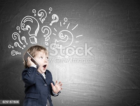istock Cute baby and question marks 629187806
