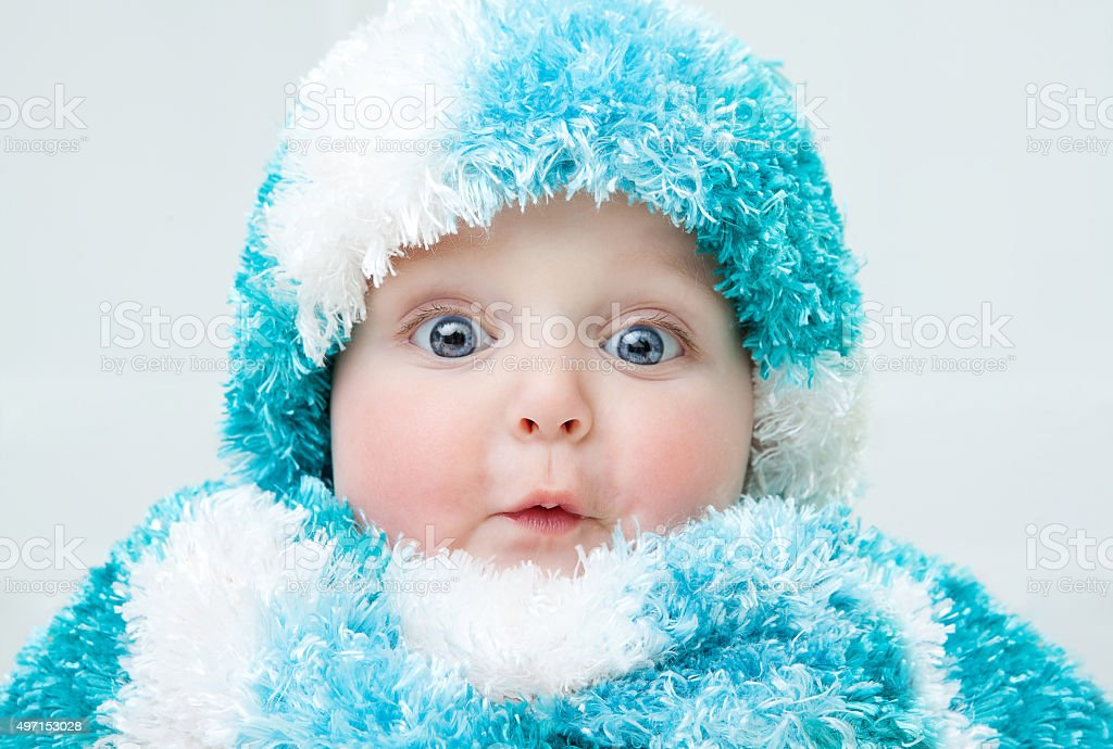 Cute baby at winter background stock photo