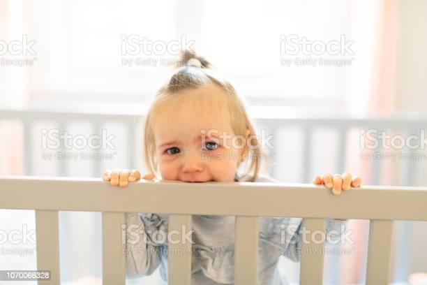 Cute baby baby on the baby room crib picture id1070066328?b=1&k=6&m=1070066328&s=612x612&h=ughsrhk llitd dhjpeet5dw02 tnr3onegppcu8lg8=