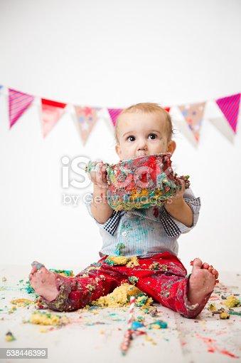 Cute Baby Boy Eating Birthday Cake During Cake Smash