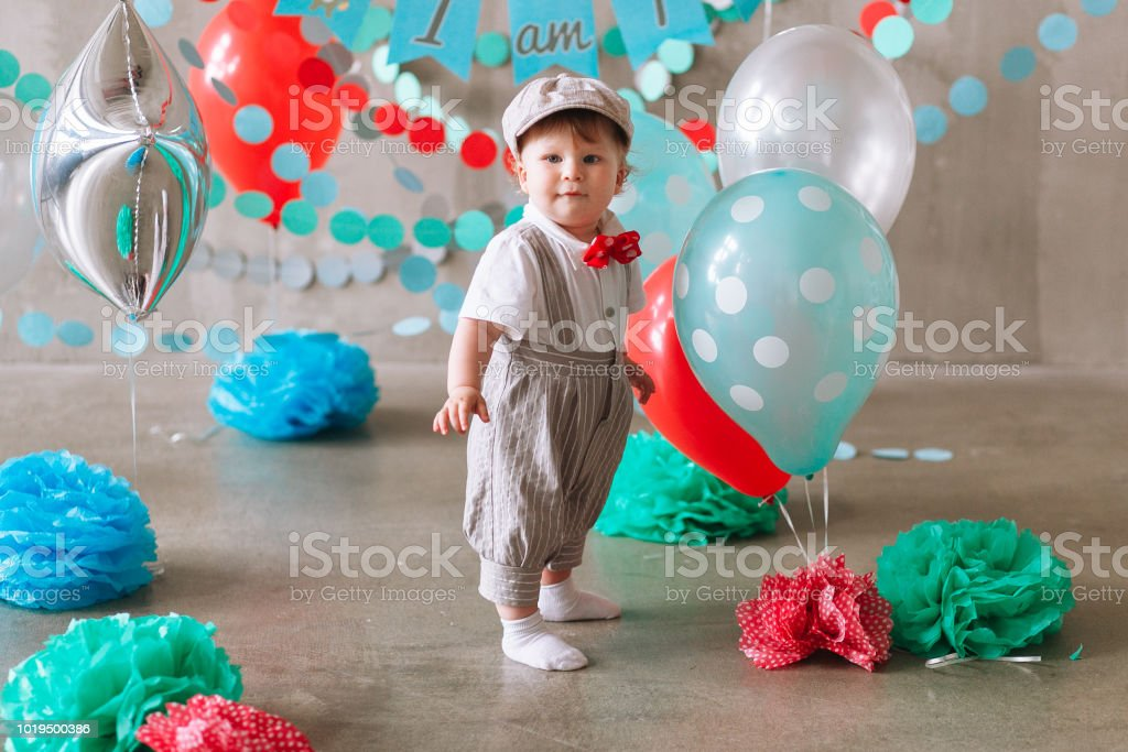 Cute Baby Boy First Birthday Party Decorated With Garland And