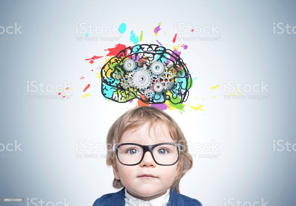 Cute baby boy in glasses, brain cogs stock photo