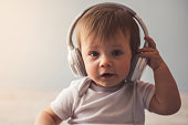 Portrait of cute baby boy with headphones smiling