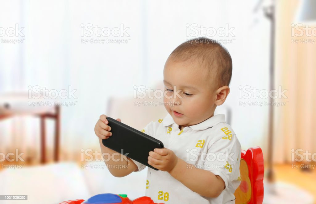 cute baby boy with phone stock photo more pictures of 6 11 months