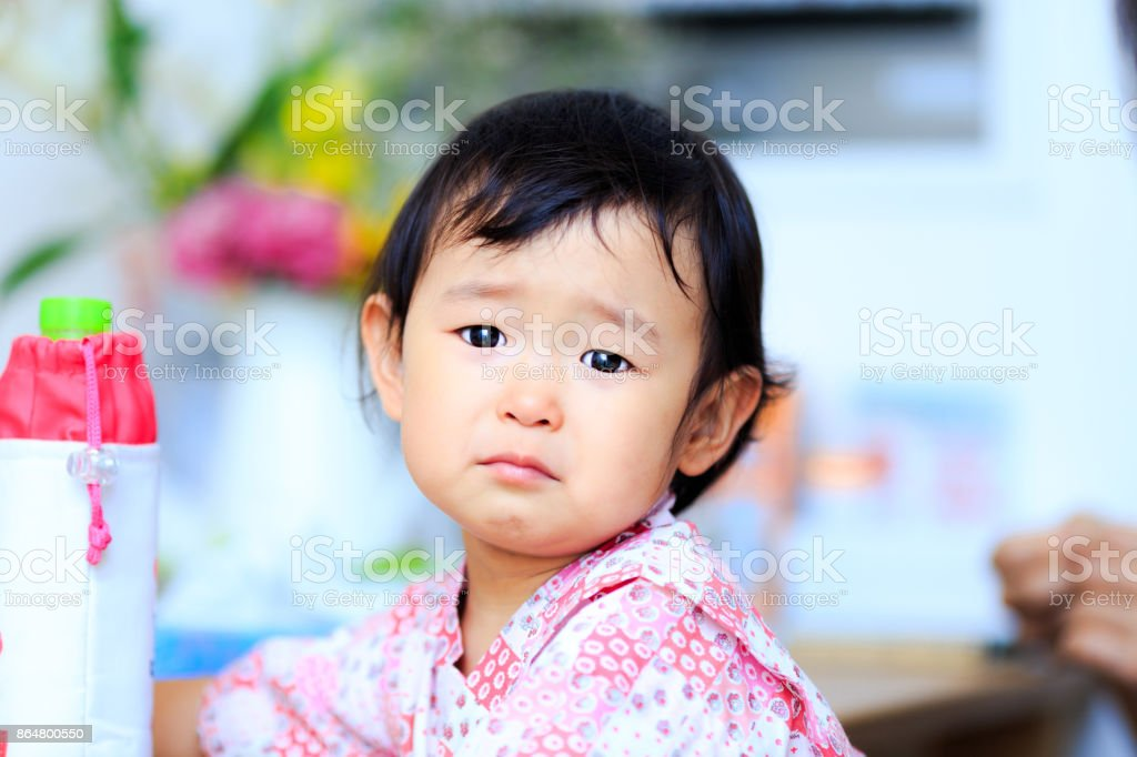 Cute baby crying stock photo