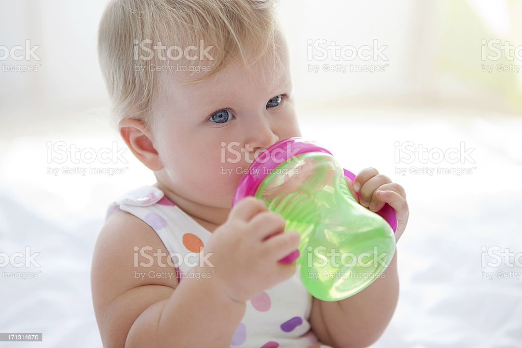 Cute baby drinking water. stock photo